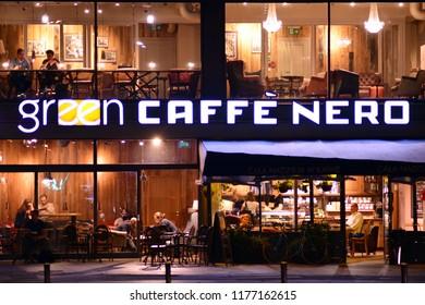 Warsaw, Poland. 10 September 2018. Sign Green Caffe Nero. Company signboard Green Caffe Nero.