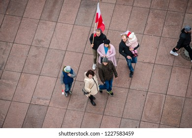 Warsaw, Poland, 11 November, 2018. Many people carring polish flags and banners during approaching to location of ceremony on the 100th anniversary of Poland regaining its independence