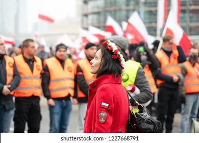 Warsaw / Poland - 11.11.2018: The Independece March. nationalists faces flags and symbols. National Independence Day 100th anniversary,