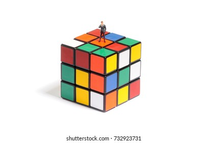 Warsaw, Poland - 17th December, 2011: Small figure of businessman on Rubik's Cube