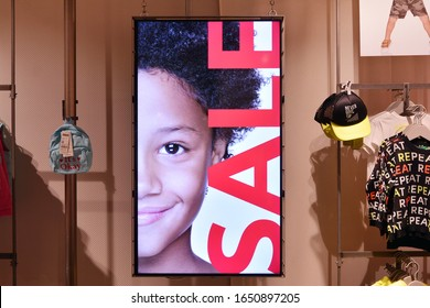 Warsaw, Poland. 18 February 2020. Digital media billboard for advertising at United Colors of Benetton fashion store.