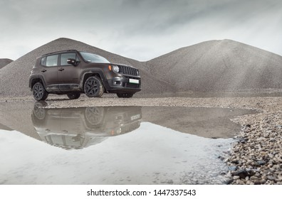 Warsaw, Poland. 20-11-2016. Jeep Renegade Night Eagle in Volcano Sand Matt paint. Surrounded by mountains of sand and stones.