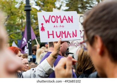"""Warsaw, Poland, 2016 10 01 - protest against anti-abortion law forced by Polish government; people with banner saying: """"woman also human"""""""
