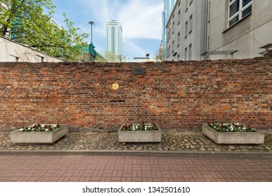 WARSAW, POLAND - 2018: A remaining fragment of the Warsaw Ghetto wall. Street Sienna 55.