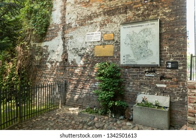 WARSAW, POLAND - 2018: Wall of the historic Jewish Ghetto in Warsaw Poland, showing plaques and map of ghetto on wall.