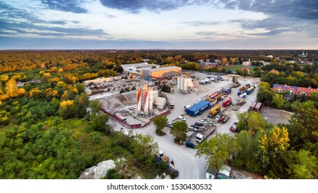 Warsaw, Poland, 2019. Industrial area in Falenica in Warsaw in Poland. Cement plant in Wawer district in Warsaw in Poland. Aerial photo. Trees and forest around.