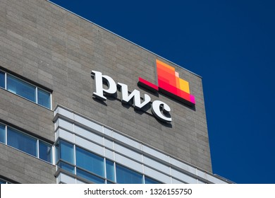 Warsaw / Poland - 2019. Logo of PWC company on facade of building in Warsaw city. - Image