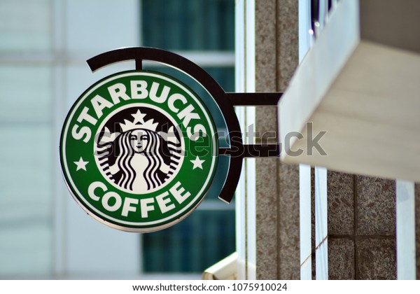 Warsaw, Poland. 23 April 2018. Sign Starbucks Coffee. Company signboard Starbucks Coffee.