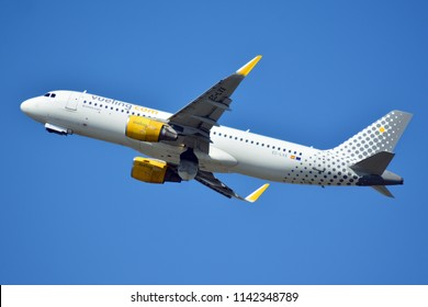 Warsaw, Poland. 24 July 2018. Airplane EC-LVX - Airbus A320-214 - Vueling Airlines  taking off from the Warsaw Chopin Airport.
