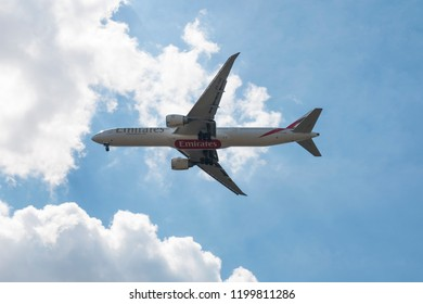 Warsaw, Poland - 24 June 2018: Emirates' Boeing 777 against blue, cloudy sky