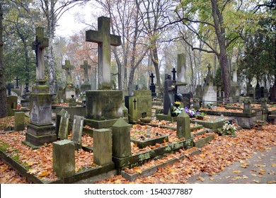 Warsaw, Poland. 24 October 2019. Old Powazki is historic cemetery in Wola District of Warsaw city. Tombstones and trees at the old cemetery.