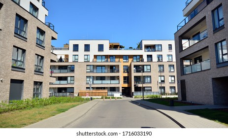 Warsaw, Poland. 27 April 2020. Modern apartment building in Wilanow district on a sunny day with a blue sky. Facade of a modern apartment.