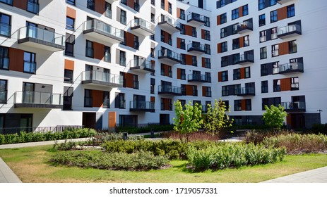 Warsaw, Poland. 27 April 2020. Modern apartment building in Mokotow district on a sunny day with a blue sky. Facade of a modern apartment.