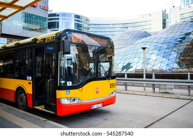 WARSAW, POLAND, 28 December 2016: A row of Warsaw red and yellow Solaris buses in the depot of Mobilis company providing bus service for the city. Central Station (Warszawa Centralna)