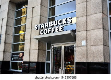 WARSAW, POLAND, 28 December 2016: Front of storie and cafe Starbucks Coffe in the center city of Warsaw in Poland. Exterior of most popular cafe STURBUCKS COFFEE.
