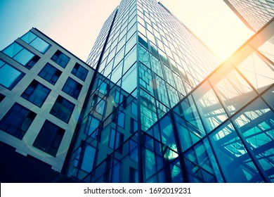 Warsaw, Poland. 28 March 2020. Varso Office building window close up with sunrise, reflection and perspective. retro stylized colorful tonal filter effe