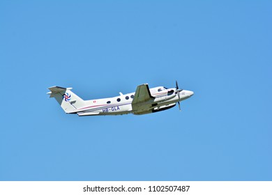 Warsaw, Poland. 28 May 2018. Passenger airplane HB-GLA - Beech B200 Super King Air is flying from the runway of Warsaw Chopin Airport