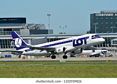 Warsaw, Poland. 28 May 2018. Passenger airplane  LOT - Polish Airlines Embraer s flying from the runway of Warsaw Chopin Airport
