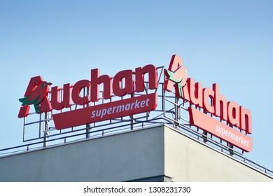 Warsaw, Poland. 8 February 2019. Sign Auchan. Company signboard Auchan.