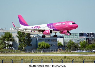 Warsaw, Poland. 8 June 2018. Plane HA-LYD - Airbus A320-232 - Wizz Air just before landing at the Chopin airport.
