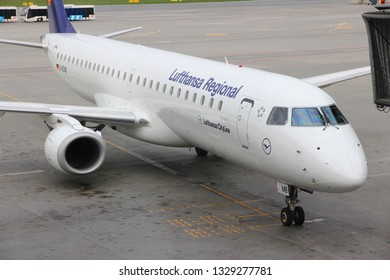 WARSAW, POLAND - APRIL 1, 2014: Embraer 195 aircraft of Lufthansa Regional airline at Warsaw Airport, Poland. Lufthansa Group carried over 103 million passengers in 2012.