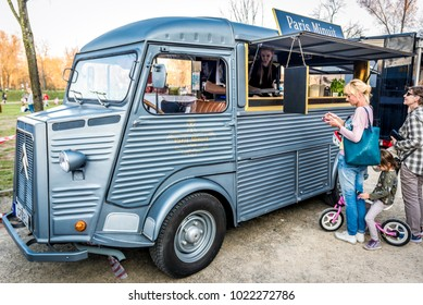 Warsaw, Poland - April 1, 2017: People in front of food truck with pancakes during food festival in Warsaw