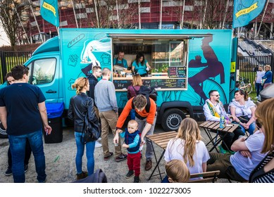 Warsaw, Poland - April 1, 2017: People in front of food truck during food festival in Warsaw