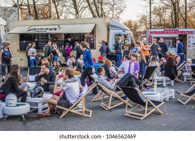 Warsaw, Poland - April 1, 2017: People in front of food trucks with pizza and burgers during food truck festival in Warsaw
