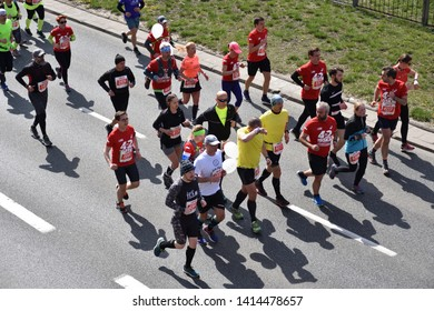 WARSAW, POLAND - APRIL 14, 2019: Orlen Warsaw Marathon. Group of athletes running on a street.