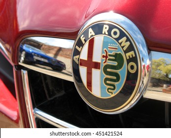 Warsaw, Poland - April, 15, 2007: Logo of Alfa Romeo and vehicle reflection in the part of grille.