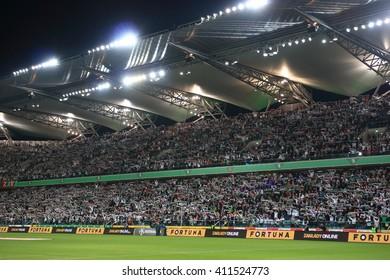 WARSAW, POLAND - APRIL 15, 2016: Legia Warsaw fanatical fans during polish league football match between Legia Warszawa and Lech Poznan in Warsaw.