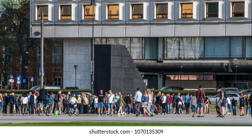 Warsaw, Poland, April 15, 2018: People around monument of plane crash victims in Smolensk