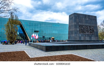 Warsaw, Poland - April 19, 2017: People attend a ceremony in front of the Warsaw Ghetto Heroes Monument to pay tribute to the Jewish fighters.