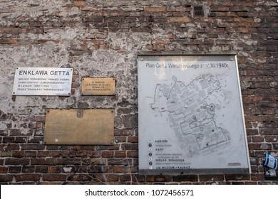 Warsaw Poland, April 2018. Wall of the historic Jewish Ghetto in Warsaw Poland, showing plaques and map of ghetto on wall.