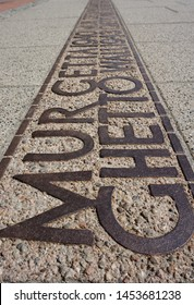 WARSAW, POLAND - April 22, 2019: Jewish Ghetto Wall built by the Nazi Germany army in 1940 during World War II. Sign on the ground floor where the wall of the Jewish Warsaw ghetto was located.