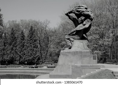 Warsaw, Poland - April 27 2019: Frederic Chopin monument. Large, bronze statue of Frederic Chopin located  in the upper part of Warsaw's Royal Baths (polish: Lazienki Park). Spring time
