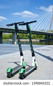 Warsaw, Poland - April 27 2019: A green Lime-S electric scooters for rent. Electric scooters parked at Vistula Boulevards promenade on the west side of the Vistula river, next to Swietokrzyski bridge.