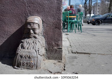 WARSAW, POLAND - APRIL 28, 2018: the angular cast-iron pedestal in form of man for limiting of swing gates in district Praga