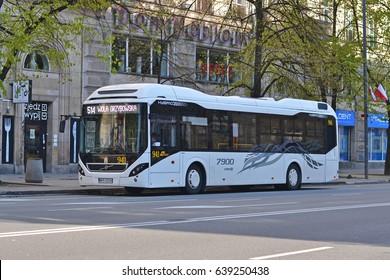 Warsaw, Poland - April, 29 , 2017: Hybrid Volvo 7900 bus on bus stop.