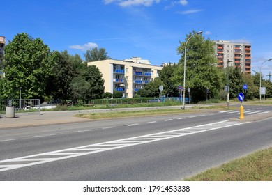 Warsaw, Poland - August 05, 2020: There are residential buildings across the street. These apartment buildings are a part of a housing estate called Goclaw.
