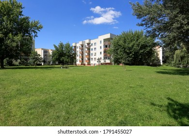 Warsaw, Poland - August 05, 2020: A large lawn near residential buildings. These buildings are part of a housing estate called Goclaw.