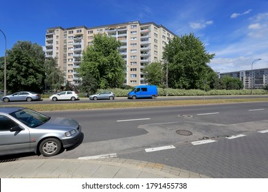 Warsaw, Poland - August 05, 2020: Large apartment building is across the street. This building is a part of a housing estate called Goclaw.