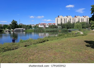 Warsaw, Poland - August 05, 2020: The lake is part of a park area in a housing estate called Goclaw. There are apartment buildings around the lake.