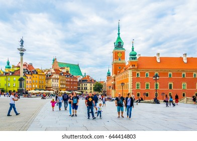 WARSAW, POLAND, AUGUST 12, 2016: People are walking over the castle square in front of the royal castle and sigismund´s column in Warsaw, Poland.