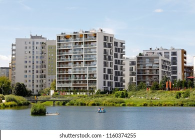 Warsaw, Poland - August 12, 2018: Buildings by the lake. It is a Warsaw district, known locally as Goclaw . Most of the buildings were built here using large panel system building technology.