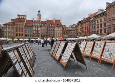 WARSAW / POLAND - AUGUST 15 2012: Sketches, paintings, watercolors and other artwork on display on A-frame stands in the Old Town Market Place.