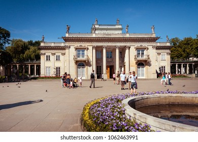 WARSAW, POLAND - AUGUST 20, 2009: Popular tourist attraction Lazienki Royal Baths Park, fountain at the Palace on the Water