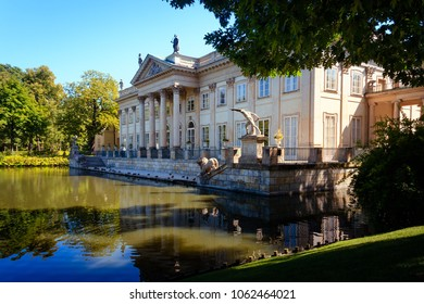 WARSAW, POLAND - AUGUST 20, 2009: Lazienki Royal Baths Park north facade of the Palace on Isle, reflecting in the pond
