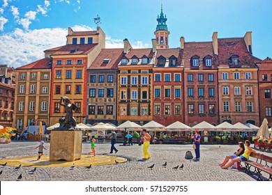 Warsaw, Poland - August 20, 2012: People at Bronze statue of Mermaid at the Old Town Market square in Warsaw, Poland