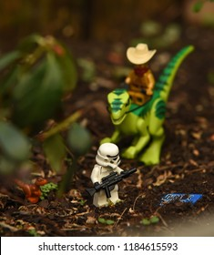 Warsaw, Poland - August 2018 - Lego Star Wars minifigures stormtrooper and protocol droid on dinosaur